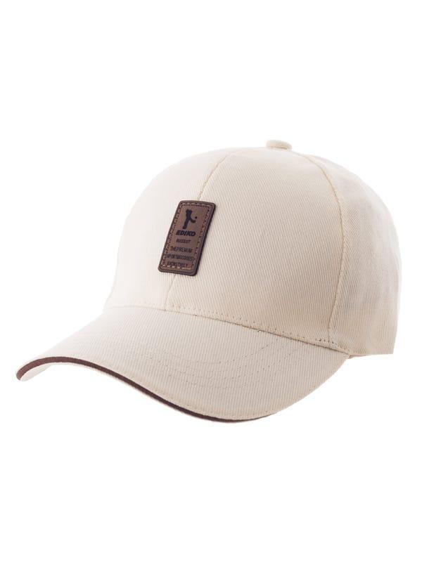 Gorra de gabardina con aplique de cuero.